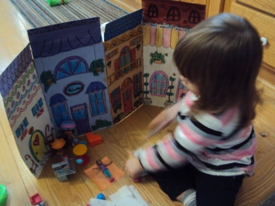 cereal box painted as a back drop for polly pocket small world play