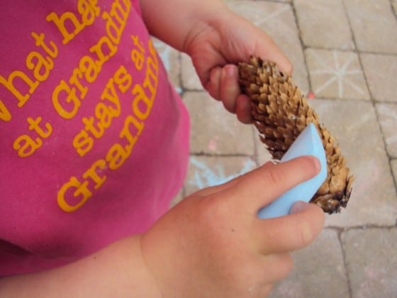 1 of 8 simple outdoor activities for toddlers - chalking on pine cones