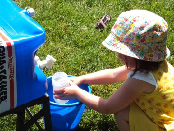 camping water container used in the yard for mud kitchen play