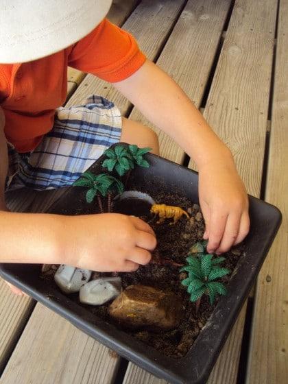 small world - dinosaur land in a flower pot