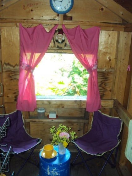 playhouse makeover - curtains and a clock make it cozy