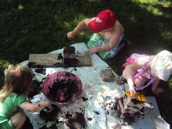 troweling mud on bricks - a mud play idea