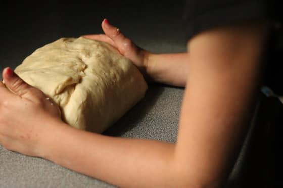 forming an oval with the dough