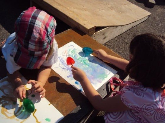 Kids painting with coloured ice