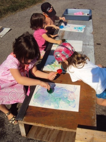 toddlers and preschoolers making art with coloured ice