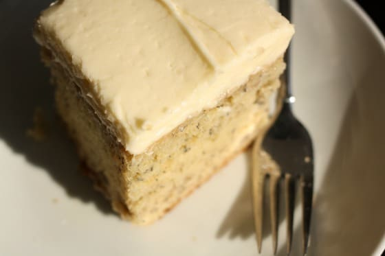 Overhead shot of Best Banana cake with cream cheese icing, plate and fork