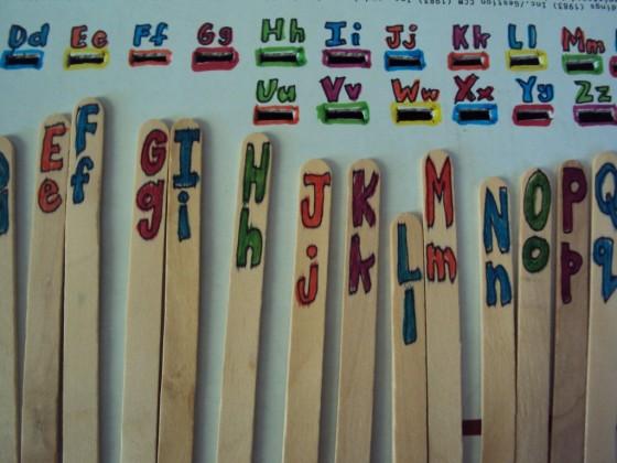 lettered craftsticks for drop activity