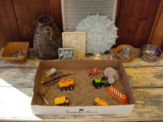 small world sensory play set up in a cardboard box