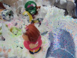 sensory bin with shaving cream and glitter