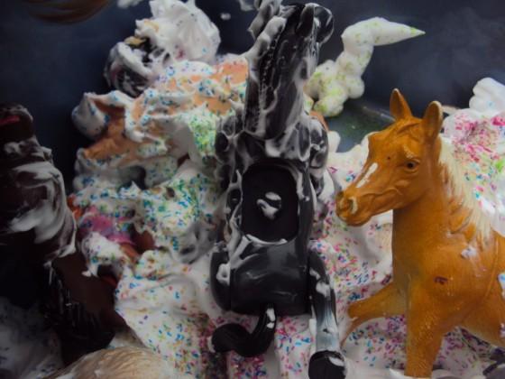 fisher-price farm animals in shaving cream and glitter