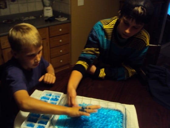 boys playing with water beads