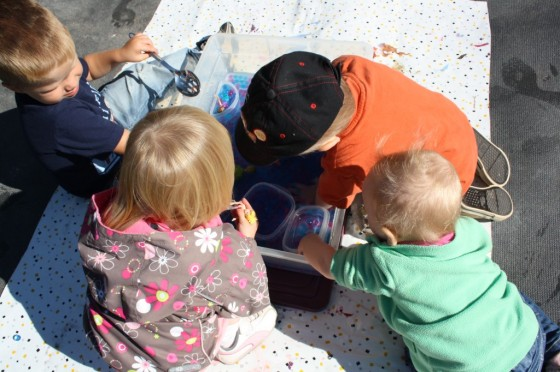 daycare kids gathered around water bead sensory bin