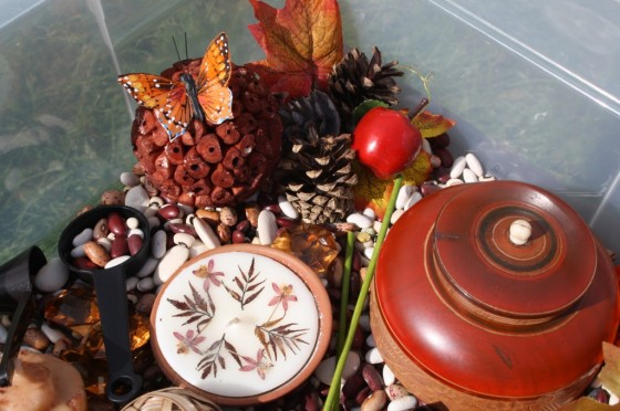 dollar store items in a fall sensory bin