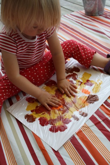 Toddler smoosh painting fall colours for fall collage