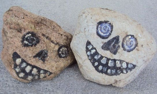 2 Rocks painted to look like skulls on front porch