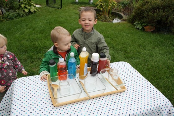 water play activity - coloured water in plastic containers