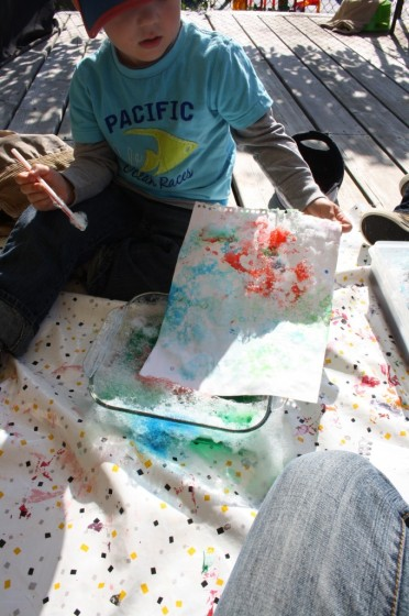 pressing paper into bubble painting