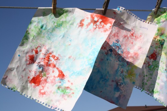 bubble paintings hanging to dry on clothesline