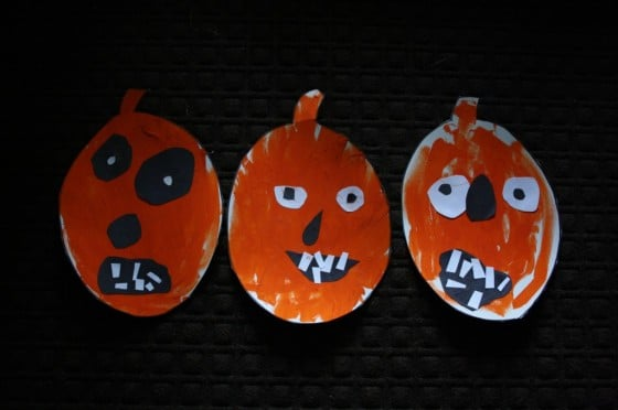 Painted jack o lanterns with face pieces cut out of paper
