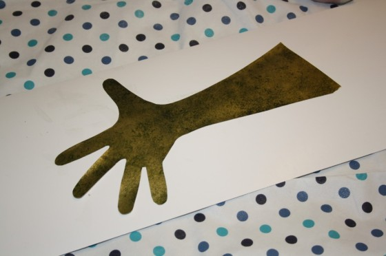 Toddler's arm and hand traced on green paper