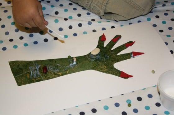 Glueing Lentil Warts on monster hand halloween craft