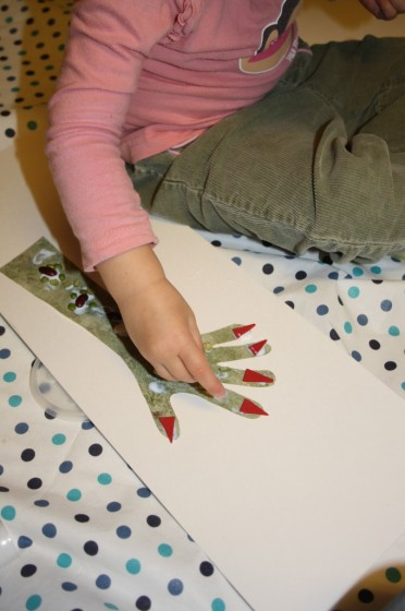 Toddler making monster hand craft for Halloween