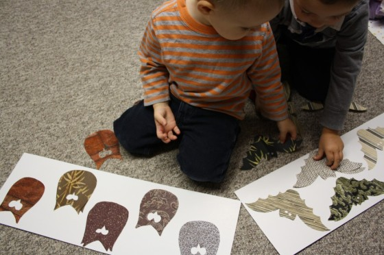 toddlers doing homemade halloween puzzle