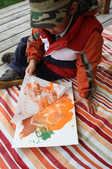 toddler creating pumpkin art