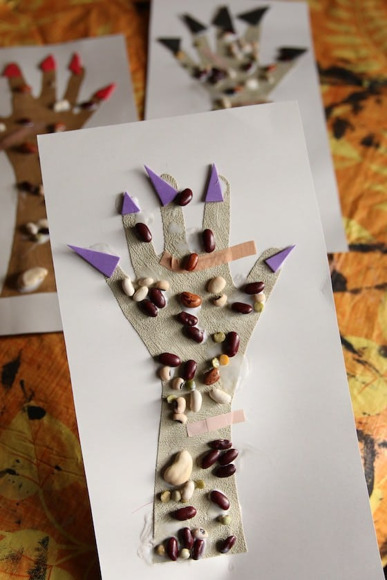 monster hand craft with lentils and bandaids