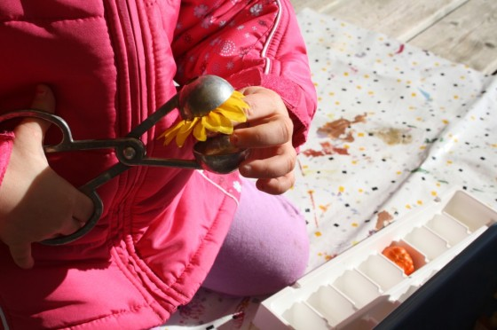 Toddler tongs and artificial sun flower
