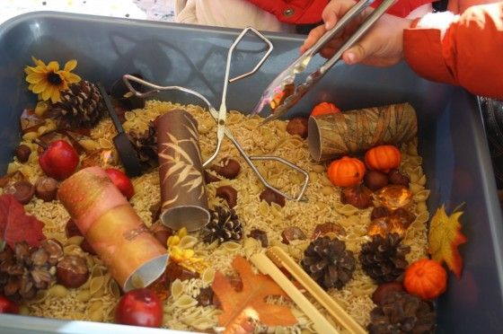 Kids playing in fall sensory bin