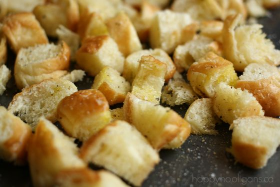 making homemade croutons from stale bread