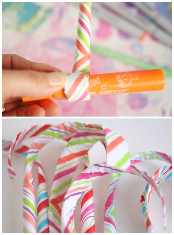 rolling up paper candy cane