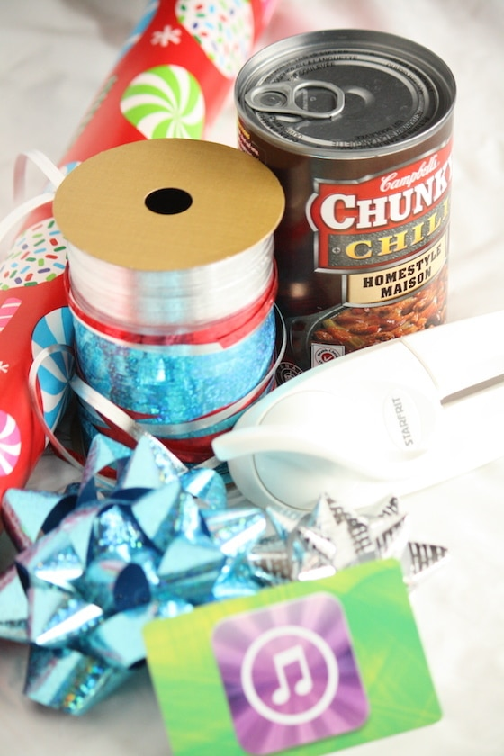 tin can with pull tab top, wrapping paper and ribbon