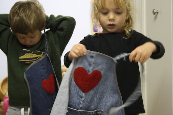 kids putting on repurposed denim aprons