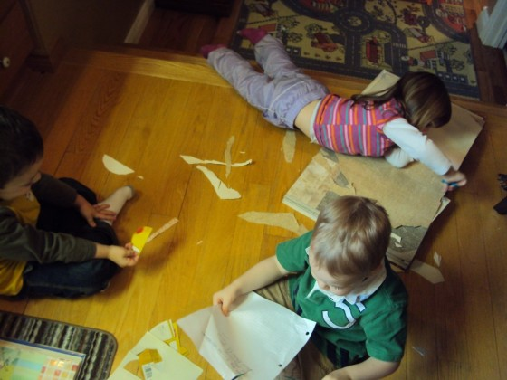 kids cutting paper to make paper cones