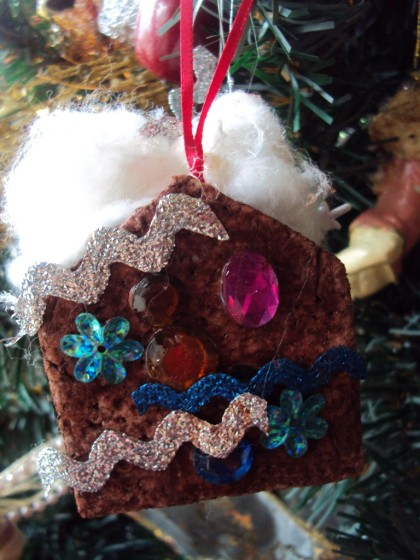 gingerbread house ornament on christmas tree