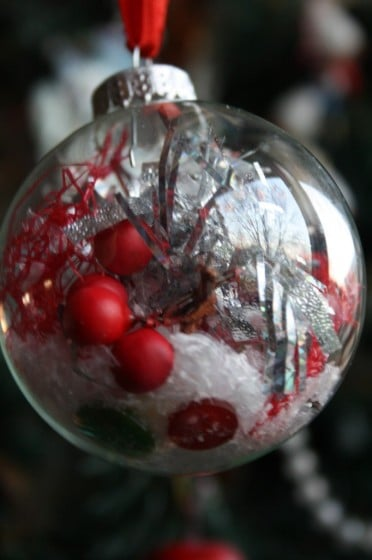 Simple Clear Glass Christmas Ornament filled by Toddler