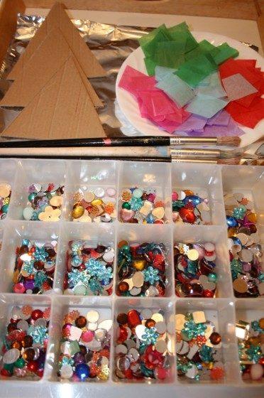 cardboard triangles, tissue paper, gems