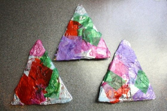 cardboard triangles covered with tin foil and tissue paper