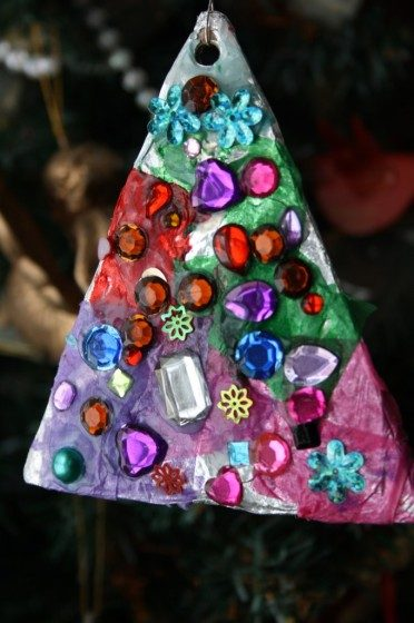 cardboard triangle covered with tin foil, tissue paper and craft gems