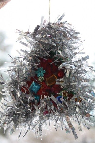 jewelled tree ornament with silver tinsel made by toddler