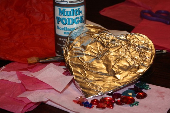 glue, cardboard heart covered with tin foil, craft gems, tissue paper