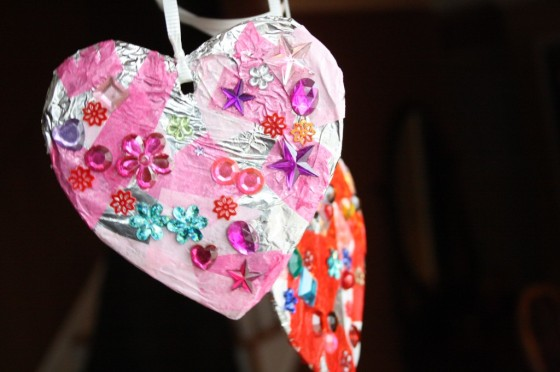 tin-foil tissue hearts with craft jewels