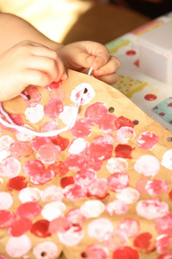 Child sewing valentine