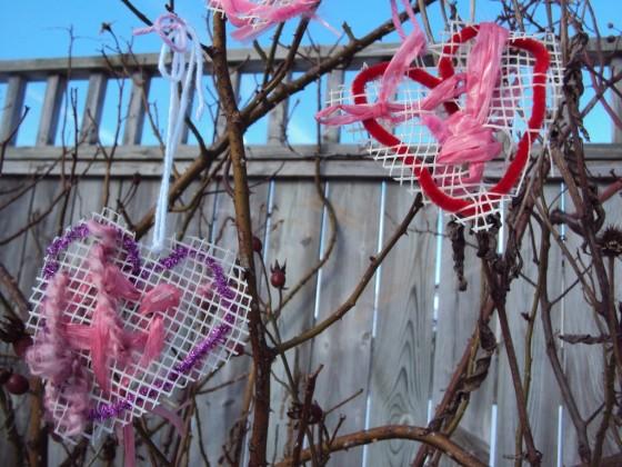 woven hearts hanging in garden