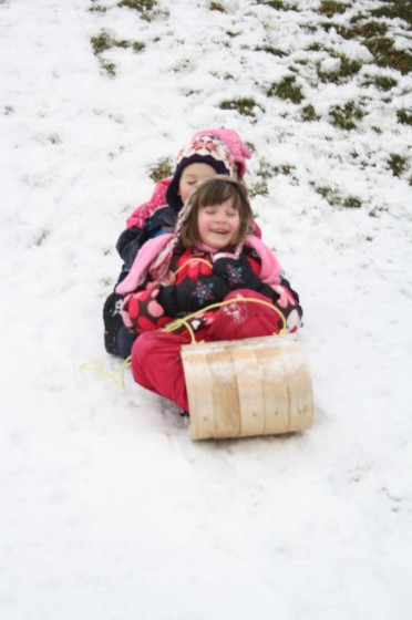 kids on wooden toboggan
