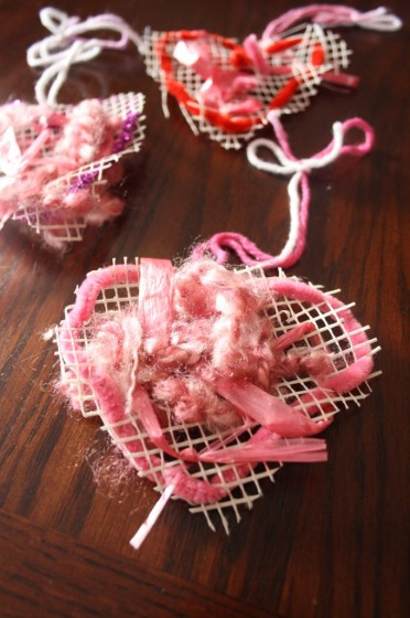 close up woven mesh heart craft made by toddlers and preschoolers