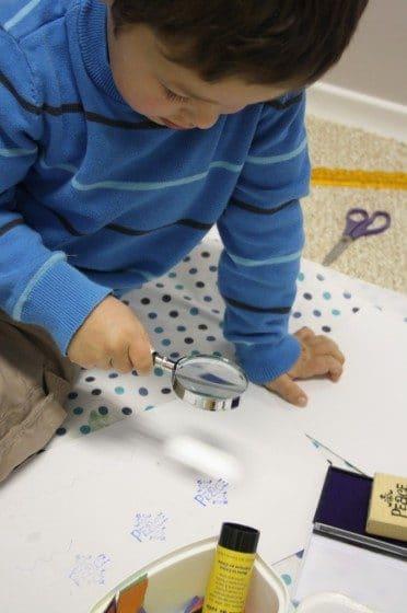 Preschooler using stamp and ink