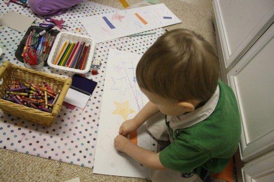 toddler stamping on paper